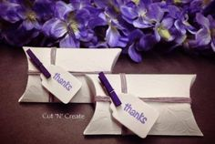 The pillow box favours created in white and purple! Love! ❤ www.cutncreate.com http://facebook.com/CutnCreate