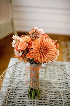 Rustic orange and peach. I really love this for our wedding and put blue as the ribbon to have both colors:)