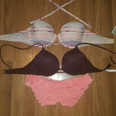 Victoria's secret swim bundle Pink top can be worn with or without straps. Size 34 DD Purple top has never been worn. 32 D with LOTS of push up.  Bottoms are coral/pink. Rouched back. Size large Victoria's Secret Swim Bikinis