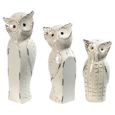 Bring a charming touch to your mantel or coffee table with these ceramic owl statuettes.  Product: Small, medium and large statuette