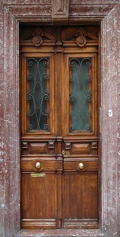 Wooden door with fossil-rich, red limestone frame, Bilbao, Spain by cocoi_m, via Flickr