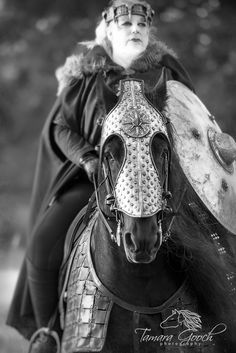 Strong women and stronger horses. This portrait shows strength and love of the baroque horse and medieval times. Fantasy photo shoots give people the chance to show a different side to their personalities.