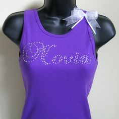 Novia in a beautiful rhinestone script on a purple tank top with detachable organdy bow.  It is available for $26.00 and shipping is free in the USA.  Go to www.debbiewendell.com/bridal-shop.
