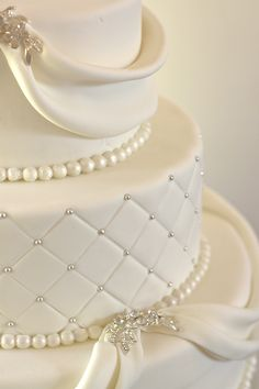 Love the details- the pearls and sparkling brooch style. Ribbons are pretty too.
