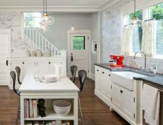 looks like they took a dining space and expanded it into the kitchen - great idea for small kitchens