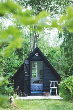 Live out your she shed dreams with this minimalistic triangular cottage that is perfect for me time.