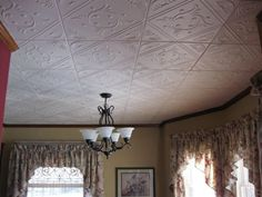 Faux  tile, Goes Over Popcorn And Most Ceiling Surfaces, made of Styrofoam, only $3.99 each  20x20 (2.7 sqft)