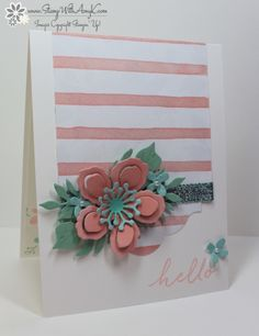 Big flower surrounded by little ones and lots off leaves. Matches pink striped paper