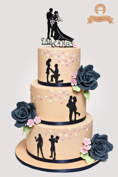 Silhouette wedding cake in peach and navy blue. Bottom tier showed how they met...then they started dating...then the proposal...and the wedding