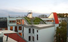 A Penthouse Rooftop with Grass Hill, Sundeck and Sports ground in Norrebro, Denmark by JDS Architects