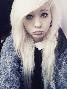 This girl has an adorable puppy dog face but she isn't fooling anyone with those black rimmed blues giving a piercing gaze!!! Clearly this white haired scene girl is looking for attention with that lip piercing because it says I'm a closet rebel!!! Beware of this beauty!!!