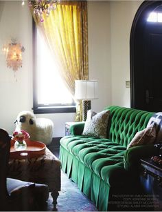 Who doesn't want a velvet green chesterfield sofa?!
