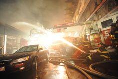 fdny:  FDNY firefighters battle a 3-alarm fire in the Bronx, 2008.