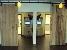 Roswell Vet - Reclaimed barn doors opened to view exam rooms