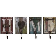 """Set of four distressed wood wall hooks. Product: 4 Piece wall hook set Construction Material: Wood Color: Distressed and painted multi Features: Heartwarming design Four hooks spell out """"HOME"""" Dimensions: H x W x D each Wall Hanger, Wall Hooks, Key Hooks, Bathroom Hooks, Diy Hangers, Clothes Hangers, Distressed Wood Wall, Barn Wood Projects, Diy Projects"""