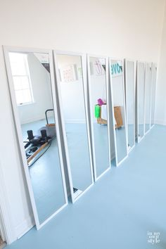 sticking mirrors on the wall - Fitness Room Mirrors