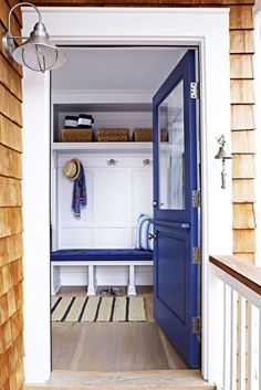 Put a mudroom at the front door. Opt for storage cubbies or built-ins that boast open bases so shoes can be kicked off and stored underneath without a traffic pileup. Organizational must-haves like hooks and baskets make arrivals (and departures) a cinch. Click through for more home decor inspiration from this beautiful and beachy New Jersey home.