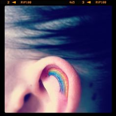 Tattoos with stories. #rainbow  When I was in high school people found out I had a girlfriend, I didn't deny it. I lost friends over it & was teased about being gay. One day someone threw a rock at my head, it cut open my ear causing it bleed everywhere & left a scar. Today I got a rainbow tattoo in that same ear. I am not ashamed of who I am, I am proud.
