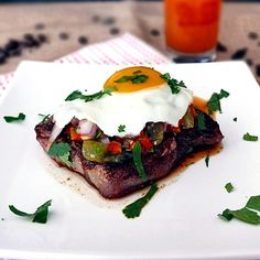 Steak and eggs with tomatillo salsa.