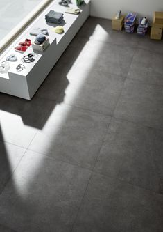 Find your collection by nameXLstoneMarazzi - With its neutral shades exalted by little white veins XLstone stone effect stoneware is ideal for the visual continuity of floors in spaces like bars. Grey Floor Tiles, Grey Flooring, Kitchen Flooring, Little White, Decoration, Stoneware, Porcelain, Grand Format, House
