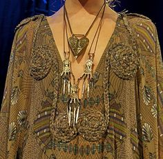 Great textile details and necklaces