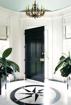 Black door with polished brass hardware