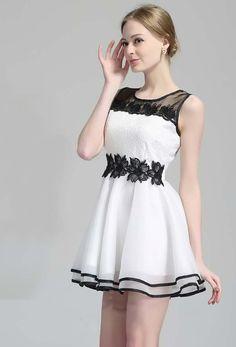 Kleid aus Organza mit Spitzedetail, schwarz-weiß 16.90