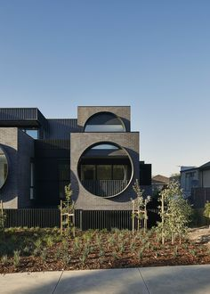 World Architecture Community News - Oversized circular windows dominate the facade of Cirqua Apartments in Melbourne Modern Residential Architecture, Facade Architecture, Melbourne Apartment, Concrete Facade, House Front Design, Apartment Projects, Building Facade, House And Home Magazine, Apartments