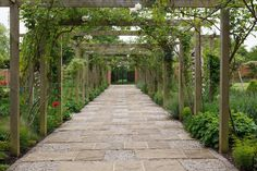 This charming walkway through the walled garden is framed by a timber pergola. The York stone paving is interspersed with stabilised gravel squares and bounded by setts. Timber Pergola, Rustic Pergola, Pergola Swing, Wooden Pergola, Backyard Pergola, Pergola Shade, Pergola Kits, Pergola Ideas, Wooden Path