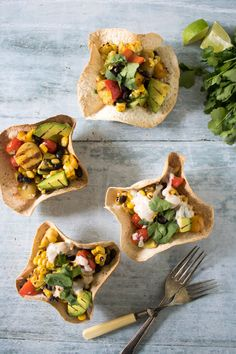 Mexican Grilled Chipotle Salad in Tortilla Bowls  >>> Don't these tortilla bowls look great? They're fun, but so easy to make. I've filled them with a salad of chipotle black beans, and barbecued corn, potatoes, mango and peppers. >>> veggiedesserts.co.uk