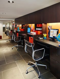 Home Office kids work space - each child has their own work area to do homework, projects, etc.... Love this idea! Plus, it is right out in the open so they can't hide internet activity as easily.