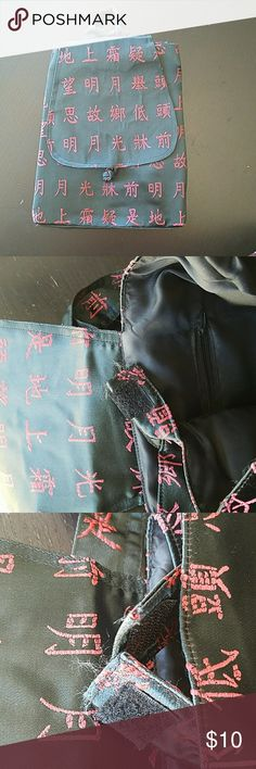 Backpack Black backpack with red Chinese characters. This was purchased during a trip to China years ago. The zipper on the back broke so it is un-zippable. This was used for a short time as a ballet ag. There is a little fraying on the velcro tabs that holds the bag's sides together, this is seen in he photo. There is also a small imperfection on the silk that can be seen in the photo. Very good condition  other than what was described. unknown  Bags Backpacks