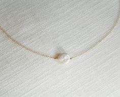 Simple Freshwater Coin Pearl Necklace by KristinaCo on Etsy https://www.etsy.com/listing/207419944/simple-freshwater-coin-pearl-necklace