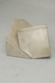 // concrete stool by Tristan Cochrane