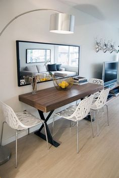 Table against wall with mirror above