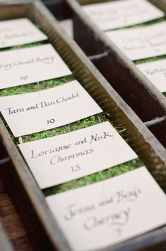 hand lettered escort cards on a bed of moss  Photography by theweaverhouse.com, Wedding Design, Coordination and Floral Design by bashplease.com