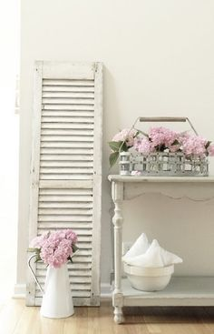Old country-white shutters are great decor...with a Shabby Chic feel (I need this for my house and we could re-use at shower with blue hydrangeas.