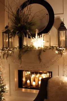 Mantel with two lanterns, round mirror and tall arrangement