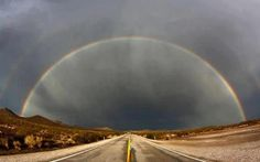 """""""A double rainbow appears after a heavy monsoon storms over Nipton Road in Searchlight, Nevada, July Photo by Gene Blevins. Caption at link (Cliché of journey with rainbow halo of hope & promise beyond current troubles) Pictures Of The Week, Pictures Images, Pretty Pictures, Funny Pictures, Somewhere Over, Lightning Strikes, Natural Phenomena, Over The Rainbow, Planet Earth"""