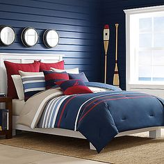 Give your bedroom a bold, colorful look with the Bradford Comforter Set from Nautica. This bed has an engineered color block stripe in a classic palette of navy, harbor, blue, red, and khaki separated by crisp white stripes.