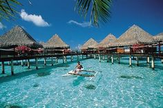 Tahiti - they delivered breakfast to our bungalow via one of these outrigger canoes. :)