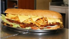 "The Gatsby, an enormous filled sandwich (think slapchips, steak, polony or viennas) has several claims to fame. Some say a restaurateur created the filled roll to feed hungry laborers, who called it a ""Gatsby smash"" or hit, after the movie playing in the nearby theatre, the Great Gatsby. Try the..."