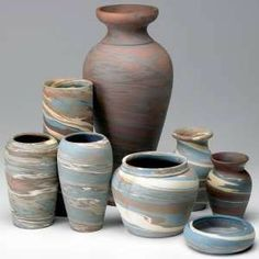 Niloak pottery. The pottery is famous for its marbleized swirls of red, blue, grey, white and other clay colors. However
