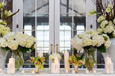 Love those urns in the back with willow, amaryllis, hydrangeas and tulips.