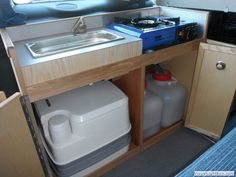 camper van unit like this beside second slider door opening for ease of access & use outside the vehicle.