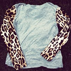 Blue sweatshirt with leopard sleeves.