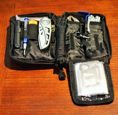My EDC tool kit (Condor Pocket Pouch).  Contents: American Medical Kits Pocket Survival Pak, fire starter kit, Gerber key chain tool, Multi 11-in-1 survival tool, 6 zip ties, Bic mini lighter, Streamlight Microlight 1A flashlight, 4 1A batteries, Gerber skeletal folding knife, Precision Screwdriver Set - 9 Pc; Torx, Phillips, eye glass repair kits and replacement screws, black paracord - 12', Oil tube, MII can opener, razor blade, vise grips, pry bar, Leatherman Skeletool and 5 pc blade kit.