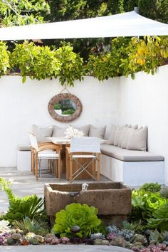 Best patio decorating ideas for A backyard guide to the essentials to make your outdoor space inviting, comfortable and functional. Read our expert tips for the perfect outdoor patio space. For more patio ideas go to Domino. Small Backyard Gardens, Small Backyard Landscaping, Backyard Patio, Outdoor Gardens, Backyard Ideas, Landscaping Ideas, Backyard Seating, Outdoor Seating, Porch Ideas