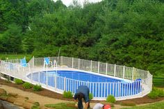WaterWorks, AG pool on hillside, fence and deck