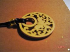 Yellow filigree wooden medallion 1 3/4 inches across 20 inch cord chain OOAKHandmade Jewelry by LadyBluesBaubles on Etsy